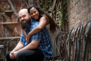 A couple poses for an engagement photo at The Firehouse in Sacramento, California.
