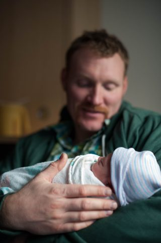 A new dad holds his brand new son at Kaiser Roseville hospital in Roseville, California.