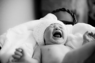 A crying baby takes a scream in Sacramento, California.