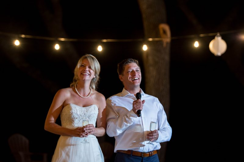 A couple thanks their friends and family at their wedding in Coloma, California.