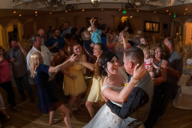 A bride and groom tearing it up on the dance floor during their wedding reception at Sequoia Mansion in Placerville, California