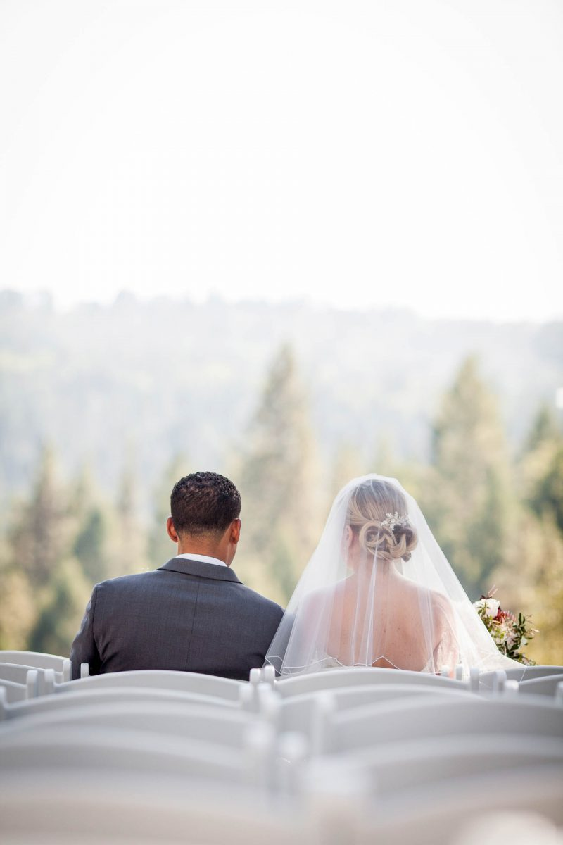 An interracial couple sharing a quiet moment together before their wedding ceremony in Placerville, California.