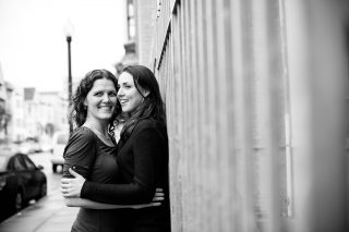 Two newly engaged women hold each other in downtown San Francisco, California.