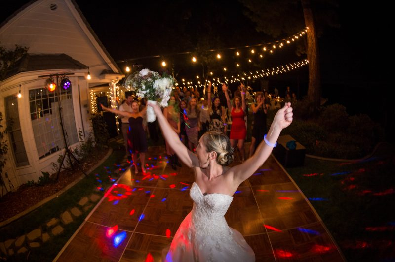 A bride is ready for the bouquet toss at her private home in Placerville, California