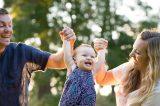 Parents enjoying their one year old at Larsen's Apple Barn Park in Camino, California